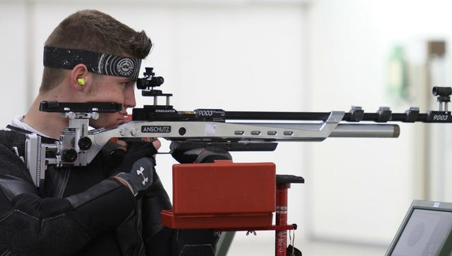 Air rifle shooter Ian Foos takes aim at a target at last year's national competition in Fort Benning, Georgia. Foos just missed qualifying for the Olympic trials being held at Camp Perry this weekend.
