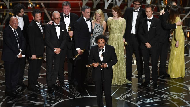 "Director Alejandro G. Inarritu and the cast and crew of ""Birdman"" accept the Oscar for best picture, one of four wins for the movie at Sunday's Academy Awards in Hollywood."