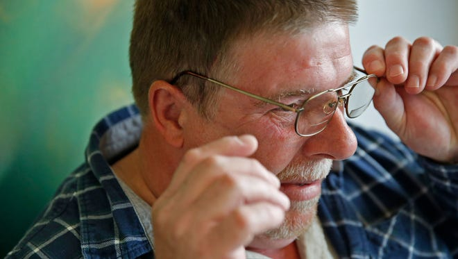 Mark Hoffman of Akron, Ind., adjusts his glasses May 1, 2017, as he waits to see his doctor at the Indiana University Health Neurotology Ear Nose and Throat Clinic in Indianapolis