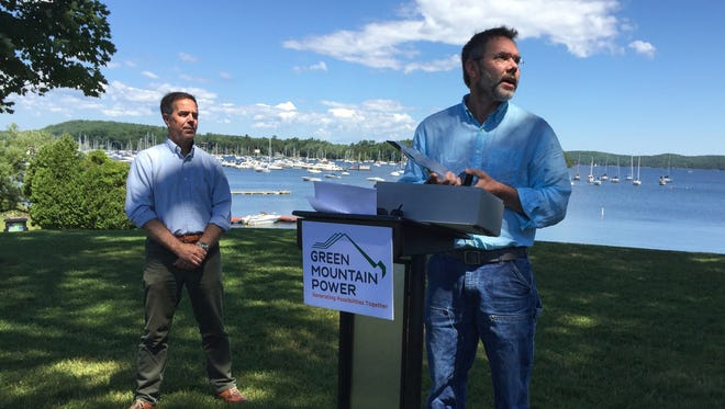 James Ehlers of Lake Champlain International, right, speaks Thursday, June 30, 2016, at Bayside Park in Colchester after receiving the 2016 Zetterstrom Environmental Award. Steve Costello of Green Mountain Power, left, presented the award, named for Milton resident Meeri Zetterstrom, an osprey advocate. The award recognizes Ehlers' work on behalf the lake and water quality.