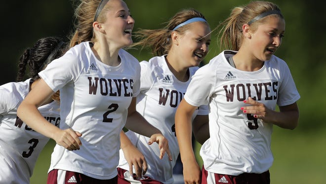 Winneconne's Emily Heyroth (2) celebrates scoring a goal with her teammates against Xavier during their WIAA Division 3 girls soccer sectional semifinal game June 8 in Winneconne.