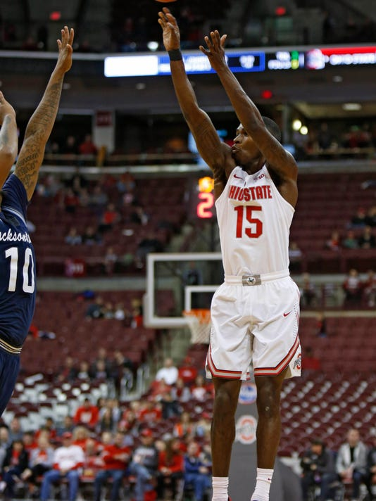 Ohio State guard Kam Williams, right, goes up for a shot against Jackson State forward Sherron Wilson during the second half of an NCAA college basketball game in Columbus, Ohio, Wednesday, Nov. 23, 2016. Ohio State won 78-47. (AP Photo/Paul Vernon)