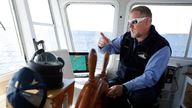 Capt. Joel Gunnlaugsson pilots a Washington Island Ferry Line ferry Washington between Northport and Washington Island on May 17, 2018. Sarah Kloepping/USA TODAY NETWORK-Wisconsin
