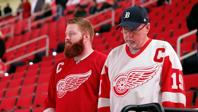 Detroit Red Wings fans look out over the ice following the cancellation of the Red Wings game with the Carolina Hurricanes due to a problem with the ice in the PNC Arena, Monday, Dec. 19, 2016, in Raleigh, N.C.