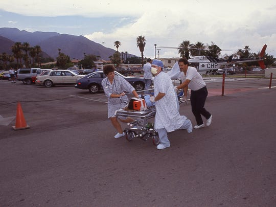 An injured Girl Scout is rolled towards the emergency room at Desert Hospital on July 31, 1991.