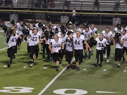 Lutheran Westland's football team rejoices following Saturday's season-opening victory.