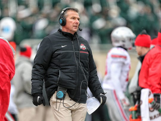 Ohio State coach Urban Meyer is dressed for the wintry elements in last week's 17-16 win at Michigan State.