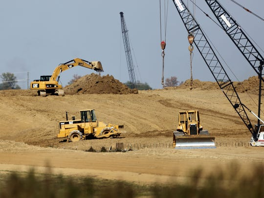 After considerable delay due to lack of funds, earth movers were busy relocating dirt for sections of I-69 in Obion County on Friday, Oct. 28, 2016.