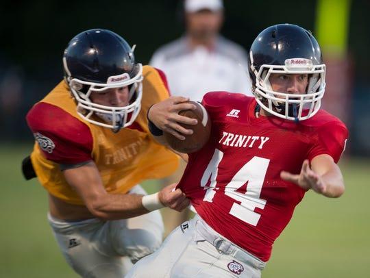 Trinity's Will Eagerton tackles Trinity's Josh Hynniman