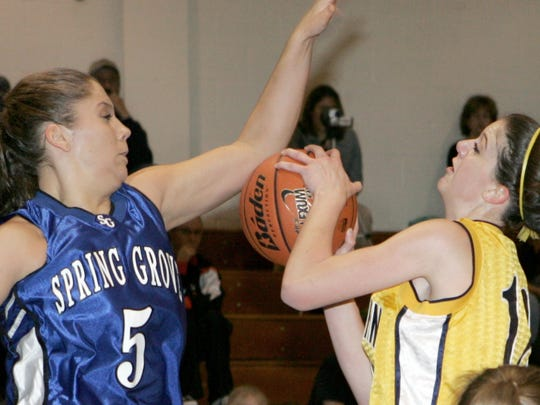 Spring Grove's Amanda McKim (5) blocks a shot in 2006.