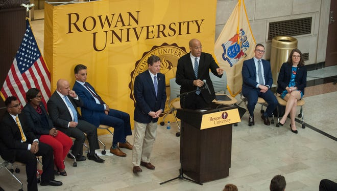 U.S. Senator Cory Booker, center right, and U.S. Representative Donald Norcross outline a major piece of legislation that would help address the teacher shortage the United States is experiencing, including increasing investments in teacher preparation programs, and offering financial assistance to encourage diversity in the teaching profession, during a press conference held at the Camden campus of Rowan University on Thursday, March 29, 2018.