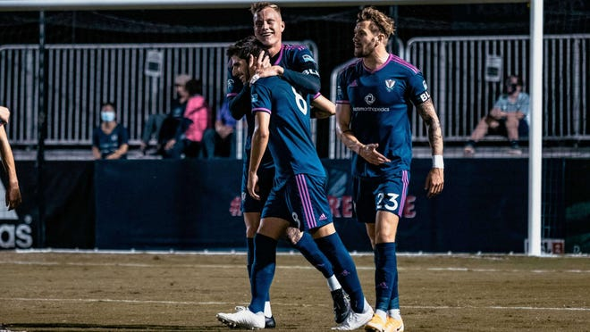 Nil Vinyals, Joshua Phelps and Curtis Thorn celebrate South Georgia Tormenta FC's first goal by Vinyals with Phelps' assist in a 4--0 win over the New England Revolution II on Wednesday night at Erk Russell Park in Statesoboro.