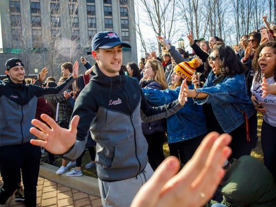 Loyola guard Clayton Custer and teammates greet fans as they welcome the Ramblers back to campus on Sunday, March 18, 2018, in Chicago, after the team advanced to the Sweet 16 of the NCAA Tournament in their first appearance since 1985. (Brian Cassella/Chicago Tribune via AP)