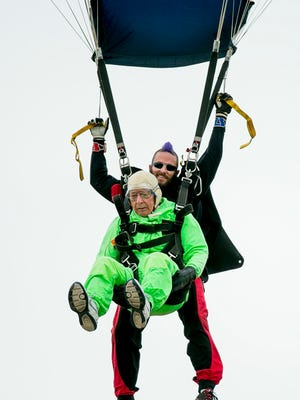 Al Blaschke, a former Wisconsinite now of Sun City, Texas, skydives with the help of instructor Aaron Burwell on his 100th birthday at Skydive Temple in Salado, Texas, on Wednesday. Blashke tied the U.S. record for oldest skydiver, according to Mark Pollack of Skydive Temple.