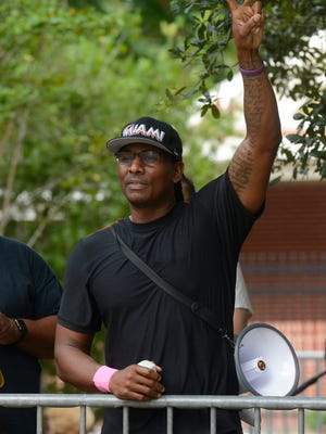 Rodney Jones leads a protest against keeping the Confederate monument in downtown Pensacola during a rally on Aug. 26, 2017.