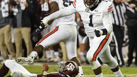 Montravius Adams (1) celebrates a sack.  Auburn at Texas A&M in College Station, Texas. on Saturday, Nov. 7, 2015.