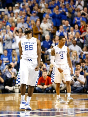 Kentucky's Dominique Hawkins celebrates after knocking down a shot against Louisville.
