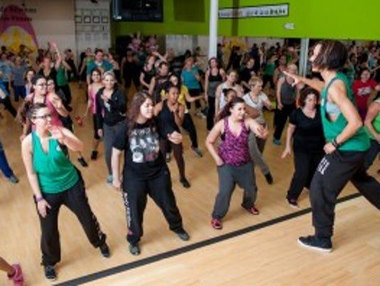 Melissa Deitz, right, leads a popular Zumba class at Body Rhythms Life Fitness.
