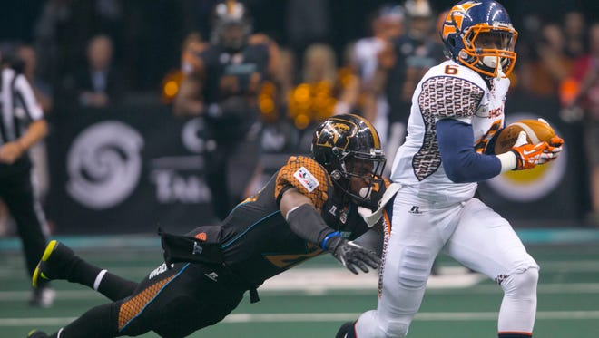 Rattlers' Jeremy Kellem tackles Shock's Brandon Thompkins in the first quarter at US Airways Center on August 10, 2013.