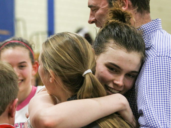 Chatham's Veronica Kelly hugs her family after scoring