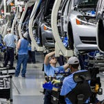 Volkswagen to shed 30,000 jobs, cutting costs after scandal