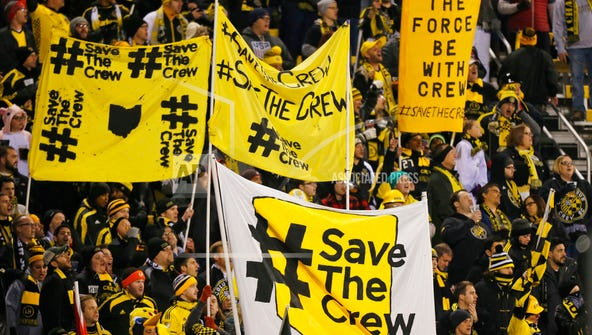 In this Oct. 31 photo, Columbus Crew fans show their