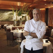 Chef Eric Ripert sniffs the truffles in the kitchen of his New York restaurant, Le Bernadin, before the lunch service.
