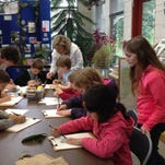 Kids draw different leaves at Straub Environmental Learning Center.