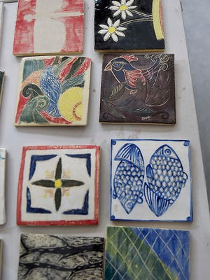 Some of the ceramic tiles made by the public at a Family Art Day on Dec. 16 at the Peninsula School of Art. The tiles will be sold for admission to the school's SOUP! soup-and-bread buffet fundraiser Feb. 3.
