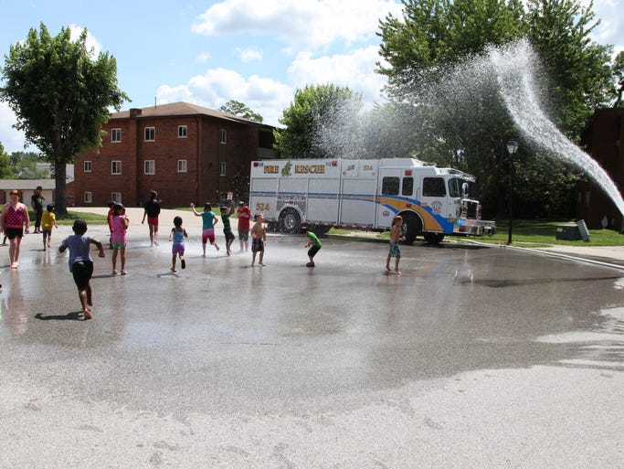 The Crescent Springs Fire Department cooled children off during River Ridge Elementary's Summer Lunch program at the Woodhill Apartments on July 9.