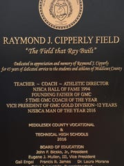 Plaque adorning home dugout at East Brunswick Tech in honor of Ray Cipperly