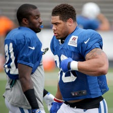 Indianapolis Colts defensive players LaRon Landry, right, and Vontae Davis suit up for the first time during training camp, on Saturday, August 2, 2014, in Anderson.