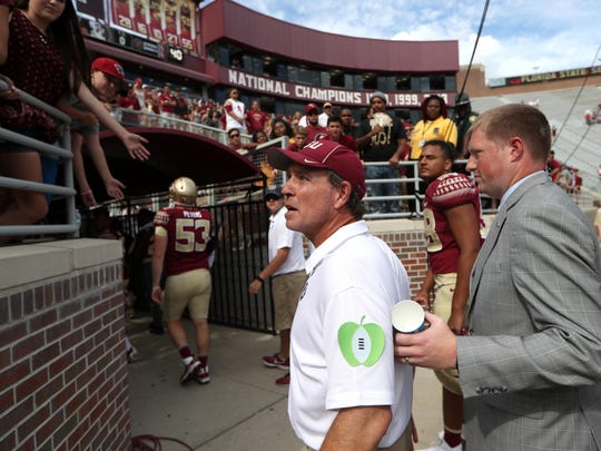 """FSU Head coach Jimbo Fisher shares a heated exchange with a fan after hearing calls for """"new coaches"""" in their 31-28 loss against Louisville at Doak Campbell Stadium on Saturday, Oct. 21, 2017."""