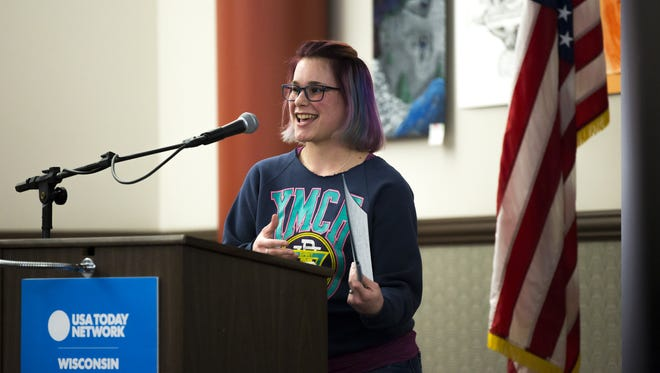 Caitlyn Gollata tells her story during the Kids in Crisis town hall in Stevens Point, Wis., Thursday, March 22, 2018.