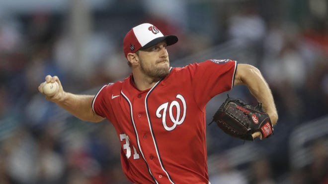 Washington Nationals starting pitcher Max Scherzer works in the first inning of a spring training  game against the Houston Astros in February.