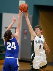 Klahowya's Jacob Kraft blocks a shot by Kai Dickerson of Chimacum on Tuesday. The Eagles say improved defense is a major factor in the team's turnaround after starting the season with six straight losses.