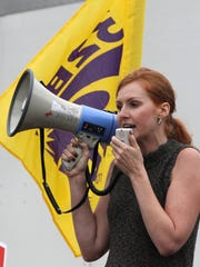 Charlotte Gusset Navarro speaks during a rally in support