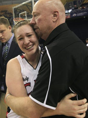 Oregon-Davis girls Head Coach Terry Minix hugs daughter Lexi Minix after their team's 69-64 victory over Vincennes Rivet in the IHSAA Class A girls basketball state final game at the Hulman Center in Terre Haute on Saturday, March 8, 2014.