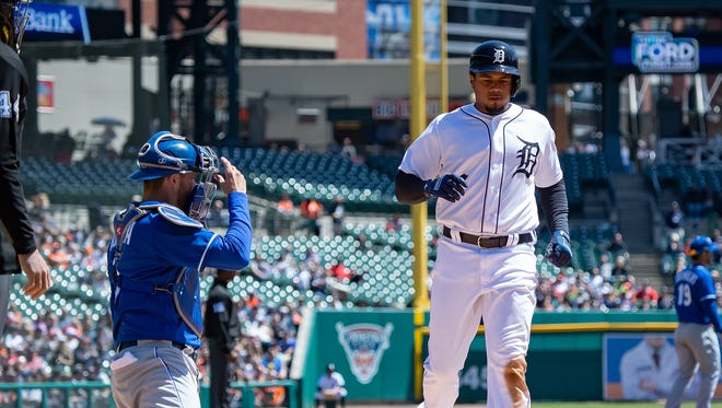 Tigers third baseman  Jeimer Candelario scores a run in the first inning on Sunday, April 22, 2018, at Comerica Park.