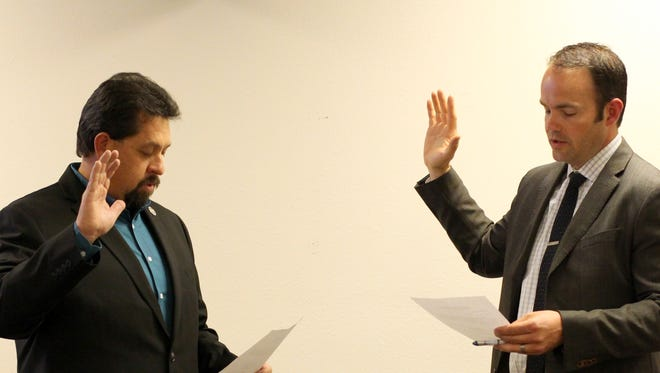 William (Billy) Ruiz, left takes his oath of office from the honorable Jarrod K. Hofacket during Thursday's Deming Public School's Board of Education meeting. Ruiz was newly elected to serve on the school board in February and attended his first meeting March 9. In addition, the DPS board elected new positions for the members which resulted in Matt Robsinson taking the title of School Board President and Dr. Francine Jacobs as the new vice president. Board member Bayne Anderson was elected to serve as board secretary for an additional term.