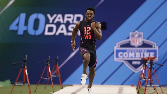 Colorado State wide receiver Michael Gallup runs the 40-yard dash during the NFL football scouting combine Saturday.