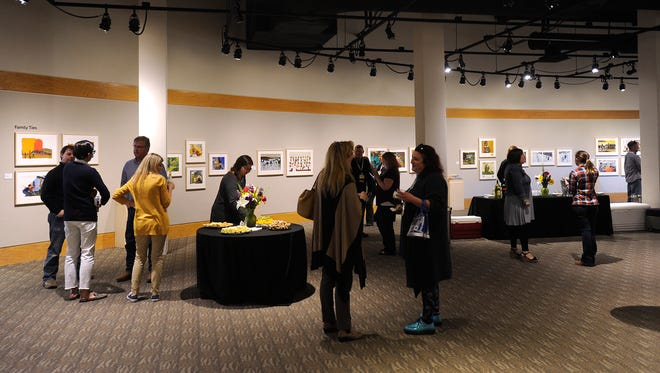 Participants in the Texas Association of Museums conference check out the artwork on display at the National Center for Children's Illustrated Literature while exploring the downtown Abilene museums on Wednesday.