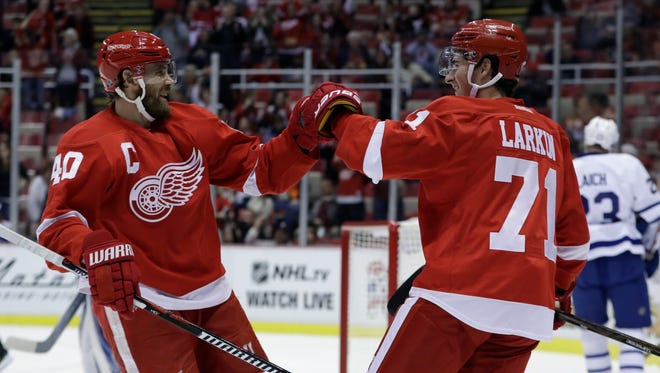 Detroit Red Wings center Dylan Larkin (71) is congratulated by teammate Henrik Zetterberg after a goal during the first period of an NHL preseason hockey game against the Toronto Maple Leafs, Saturday, Oct. 8, 2016, in Detroit.