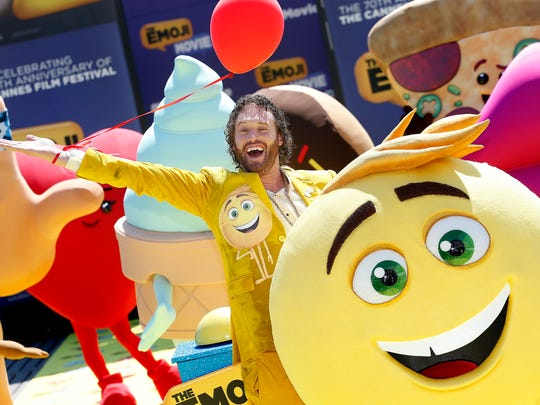 Actor T.J. Miller poses with Emoji characters during
