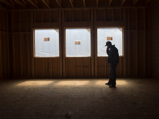 Scott Weaver shows off the second floor of his new bar, Traegers, in Farmington on Thursday.