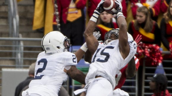 Here, Grant Haley (15) makes an acrobatic interception at Maryland in a close 2015 victory. He and safety Marcus Allen (2) have teamed on a few huge plays over the years.