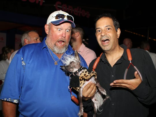 Larry The Cabke Guy looks at Rascal, the world's ugliest dog, Wednesday at Edgewood Tahoe.