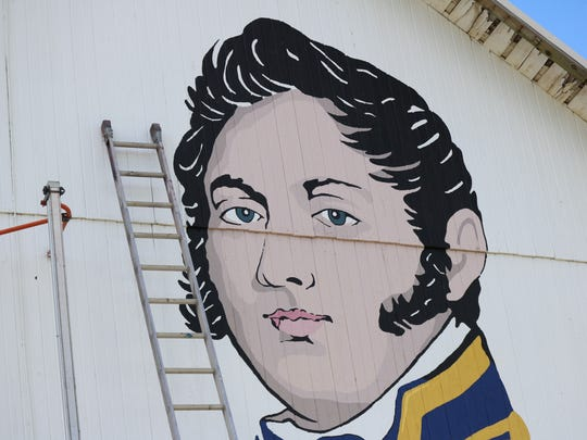 The barn mural featuring Oliver Hazard Perry is being created days after the 204th anniversary of Perry's victory at the Battle of Lake Erie on Sept.10, 1813.