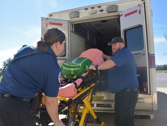 Kourtenay Devlin, an Escambia County emergency medical technician, and paramedic James Cope load an ambulance Tuesday, Nov. 14, 2017, at the county's new EMS operation in Walnut Hill.