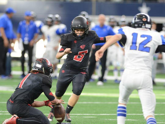 Strawn's K-Lani Nava kicks an extra point during the Greyhounds' 78-42 win over Balmorhea in the Class 1A Division II state championship game in December at AT&T Stadium in Arlington.